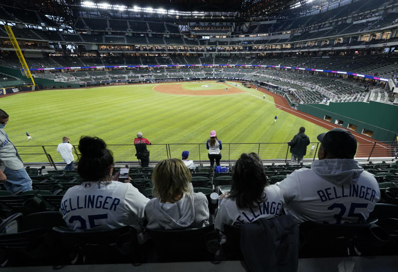 ARLINGTON, TX - OCTOBER 23: Fans watch batting practice before Game 3 of the 2020 World Series between the Los Angeles Dodgers and the Tampa Bay Rays at Globe Life Field on Friday, October 23, 2020 in Arlington, Texas. (Photo by Cooper Neill/MLB Photos via Getty Images)