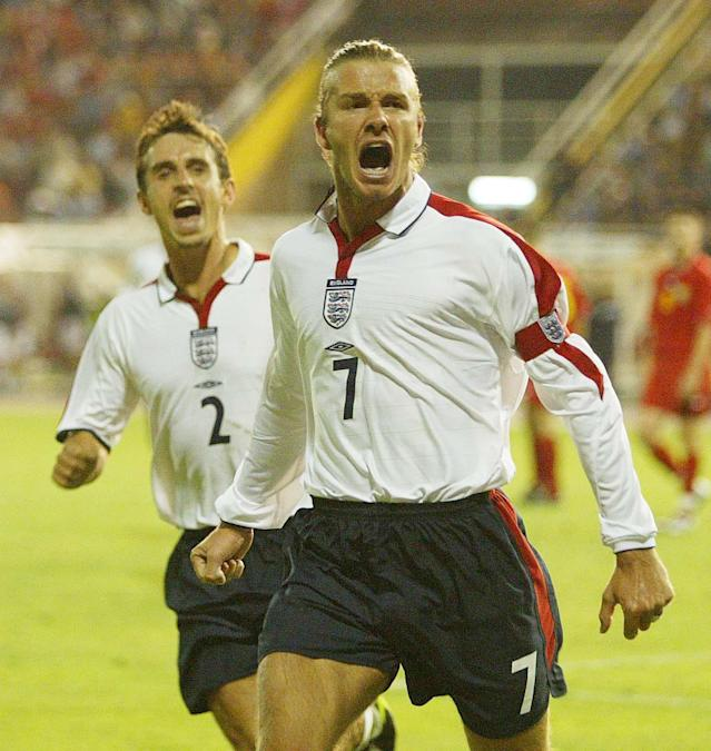 File photo dated 06/09/2003 of England captain David Beckham (right) celebrating scoring from the penalty spot against Macedonia with team mate Gary Neville during their group seven Euro 2004 qualifying match at The City Stadium, Skopje, Macedonia.