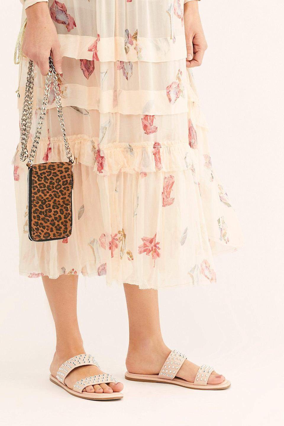 """<h3><a href=""""https://www.freepeople.com/sale-all/"""" rel=""""nofollow noopener"""" target=""""_blank"""" data-ylk=""""slk:Free People"""" class=""""link rapid-noclick-resp"""">Free People</a></h3> <br><strong>Dates:</strong> Limited time<br><strong>Discount:</strong> Up to 50% off<br><strong>Promo Code:</strong> None<br><br><strong>Inuovo</strong> Parker Studded Slide Sandals, $, available at <a href=""""https://go.skimresources.com/?id=30283X879131&url=https%3A%2F%2Fwww.freepeople.com%2Fshop%2Fparker-studded-slide-sandals%2F%3Fcategory%3Dsale-all%26color%3D066"""" rel=""""nofollow noopener"""" target=""""_blank"""" data-ylk=""""slk:Free People"""" class=""""link rapid-noclick-resp"""">Free People</a><br><br><br>"""