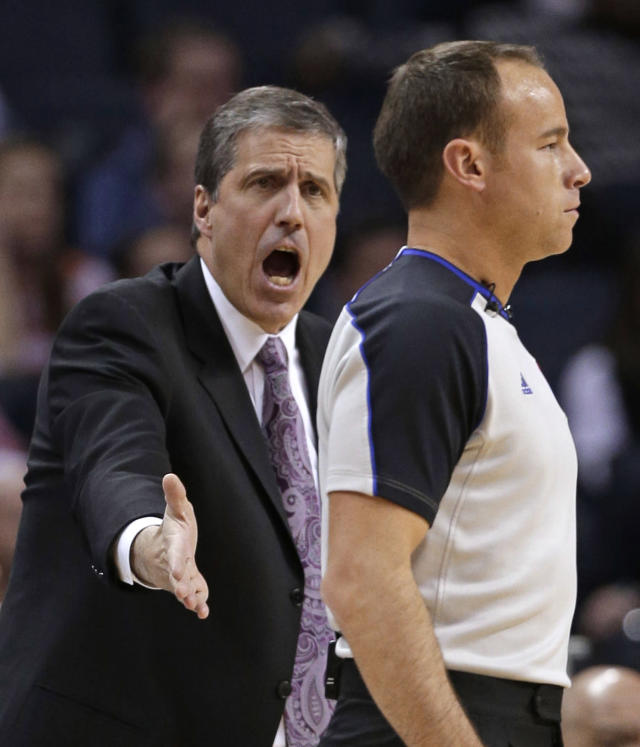 Washington Wizards coach Randy Wittman, left, argues a call with referee Josh Tiven during the first half of an NBA basketball game against the Charlotte Bobcats in Charlotte, N.C., Tuesday, Jan. 7, 2014. (AP Photo/Chuck Burton)