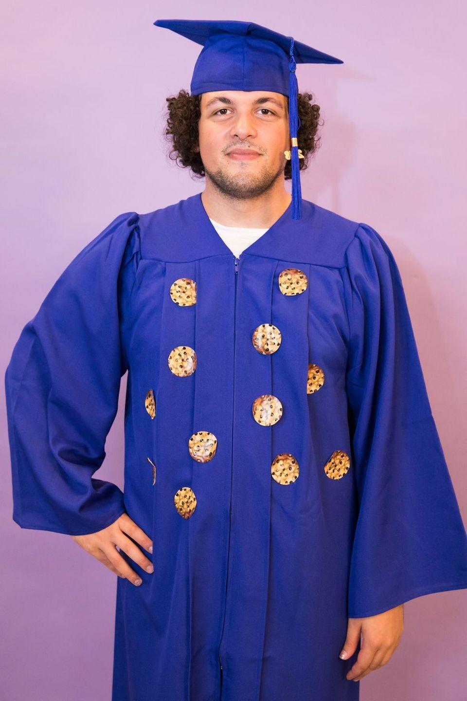 """<p>If you still have your graduation gown, you can replicate this costume in seconds. Or, you can buy a set for under $25.</p><p><a class=""""link rapid-noclick-resp"""" href=""""https://www.amazon.com/GraduationForYou-Matte-Graduation-Tassel-45inFF/dp/B01M03XKSY/?tag=syn-yahoo-20&ascsubtag=%5Bartid%7C10055.g.21965973%5Bsrc%7Cyahoo-us"""" rel=""""nofollow noopener"""" target=""""_blank"""" data-ylk=""""slk:SHOP CAP AND GOWN"""">SHOP CAP AND GOWN</a></p>"""