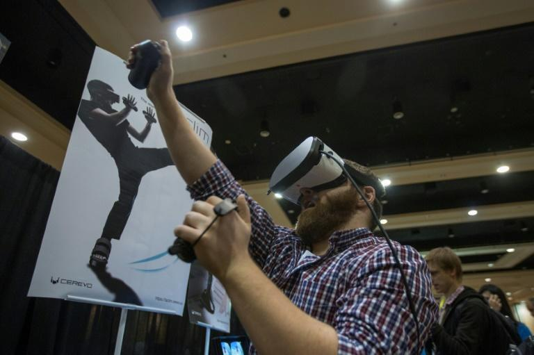A man tries out the Taclim virtual reality system during the 2017 Consumer Electronics Show (CES) in Las Vegas, Nevada on January 3, 2017