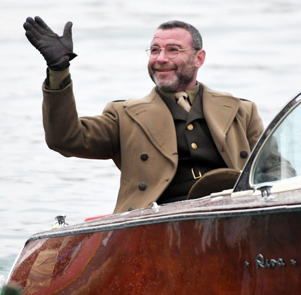 <p>Liev Schreiber waves while filming scenes for <em>Across the River and into the Trees</em> in Venice, Italy, on Wednesday.</p>