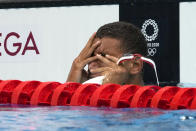 Ahmed Hafnaoui, of Tunisia, reacts after winning the final of the men's 400-meter freestyle at the 2020 Summer Olympics, Sunday, July 25, 2021, in Tokyo, Japan. (AP Photo/Martin Meissner)