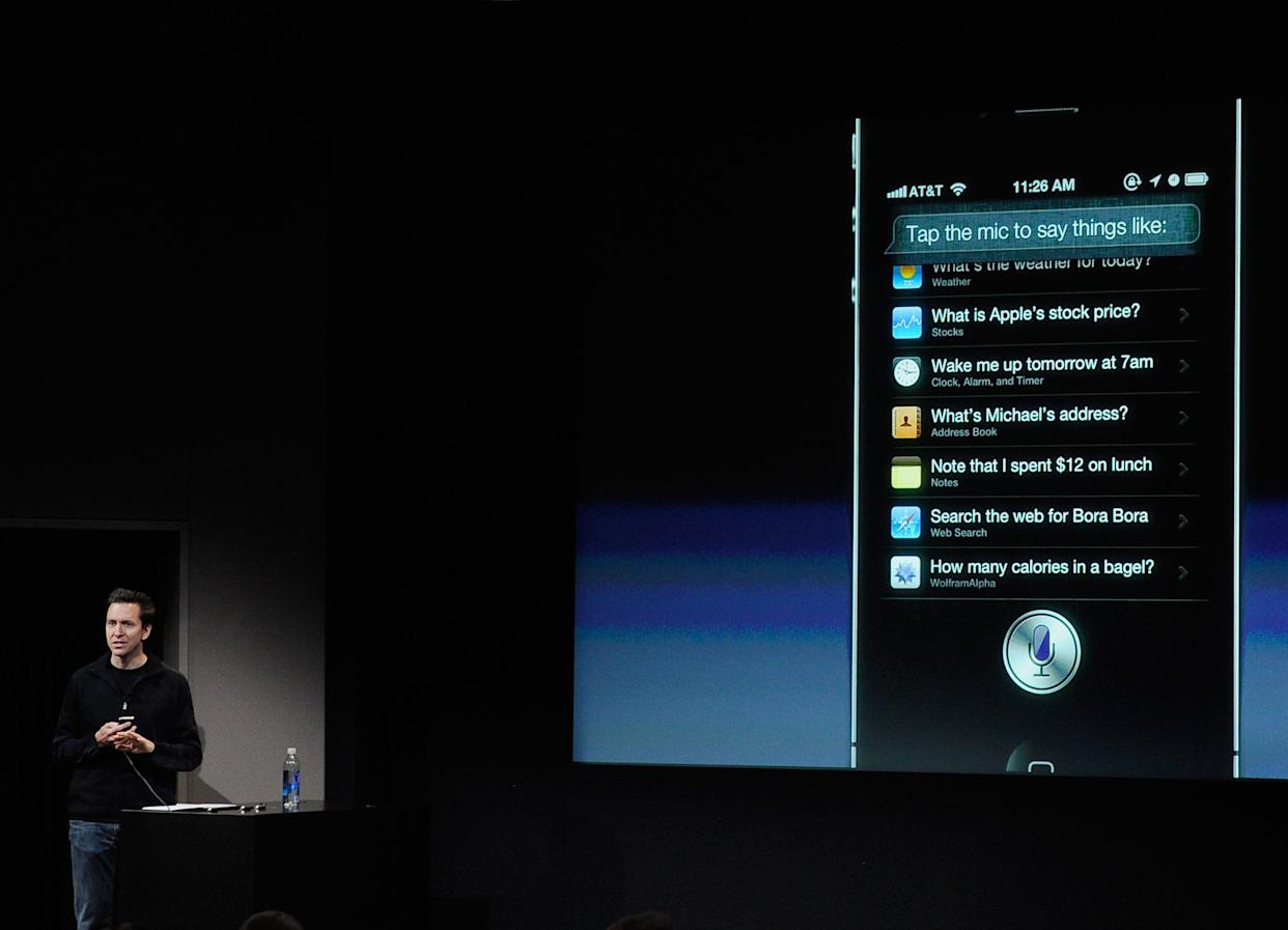 Apple's Senior Vice President of iOS Scott Forstall speaks about the new voice recognition app called Siri at the event introducing the new iPhone 4s at the company's headquarters October 4, 2011 in Cupertino, California. (Photo credit: Kevork Djansezian/Getty Images)