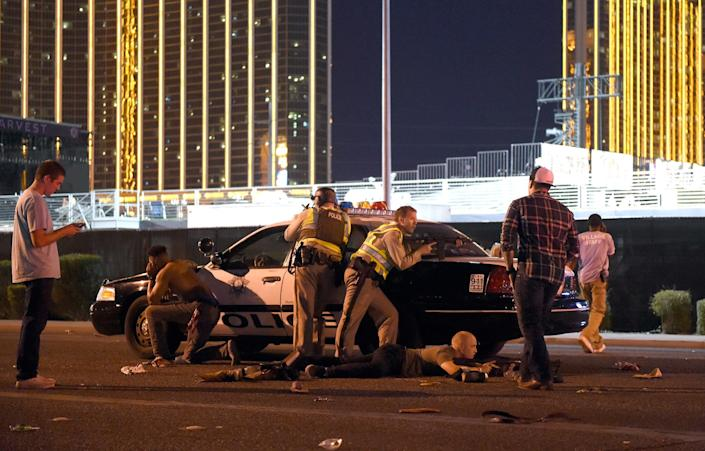 Las Vegas police search for the gunman while protecting fleeing fans.