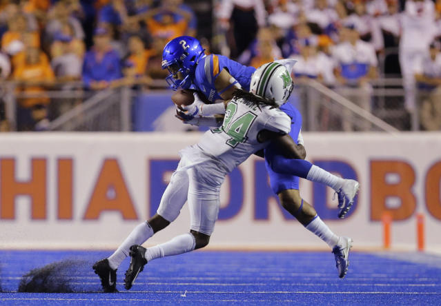 Boise State wide receiver Khalil Shakir (2) makes a catch over Marshall defensive back Steven Gilmore (34) during the second half of an NCAA college football game in Boise, Idaho, Friday, Sept. 6, 2019. Boise State won 14-7. (AP Photo/Otto Kitsinger)