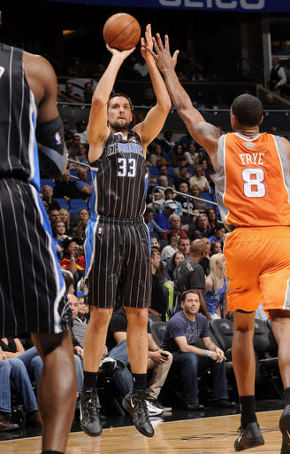 ORLANDO, FL - MARCH 21: Ryan Anderson #33 of the Orlando Magic takes a jump shot over Channing Frye #8 of the Phoenix Suns during the game on March 21, 2012 at Amway Center in Orlando, Florida. (Photo by Fernando Medina/NBAE via Getty Images)