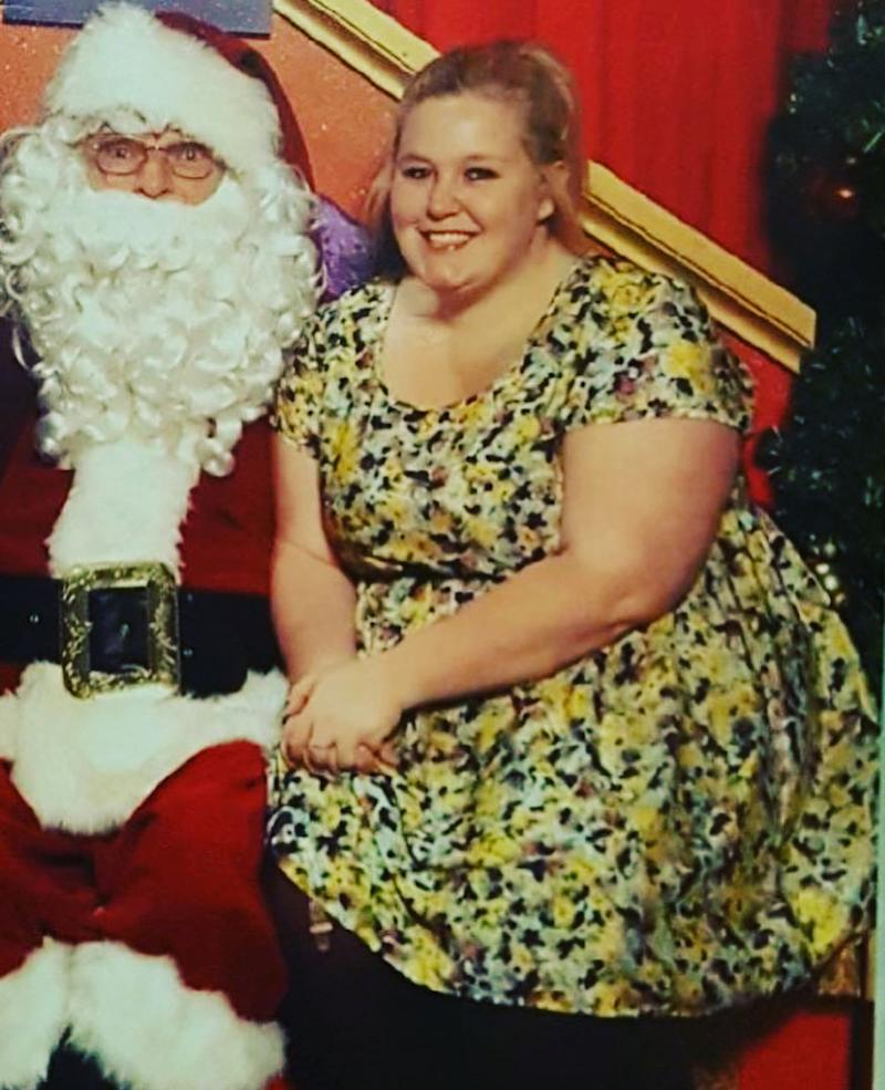 Alida Dreyer sitting on Santa's knee