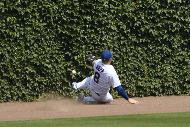 Chicago Cubs center fielder Ian Happ (8) misses an RBI-double by Milwaukee Brewers' Omar Narvaez during the seventh inning of a baseball game Saturday, July 25, 2020, in Chicago. (AP Photo/Paul Beaty)