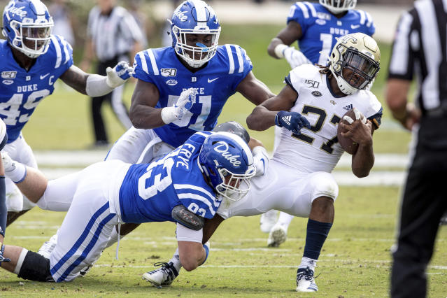 Georgia Tech's Jordan Mason (27) is tackled by Duke's Ben Frye (93) during an NCAA college football game in Durham, N.C., Saturday, Oct. 12, 2019. (AP Photo/Ben McKeown)