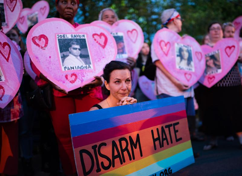 A diverse coalition of groups and activists held an overnight peace vigil in front of the National Rifle Assiciation's (NRA) offices in Fairfax, VA to honor the 49 people killed in the mass shooting in Orlando. They called for a ban on assault weapons. (Sarah L. Voisin/The Washington Post via Getty Images)