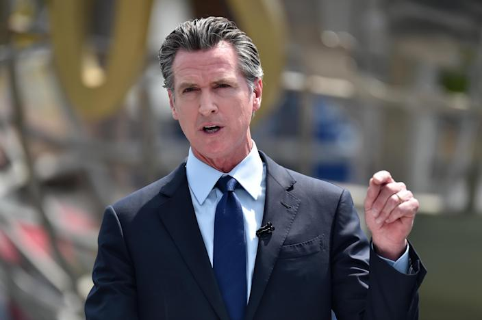 California Governor Gavin Newsom attends a press conference for the official reopening of the state of California at Universal Studios Hollywood on June 15, 2021. / Credit: Alberto E. Rodriguez / Getty Images