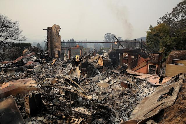 <p>The remains of the fire damaged Signarello Estate Winery after an out of control wildfire moved through the area on Oct. 9, 2017 in Napa, Calif. (Photo: Justin Sullivan/Getty Images) </p>