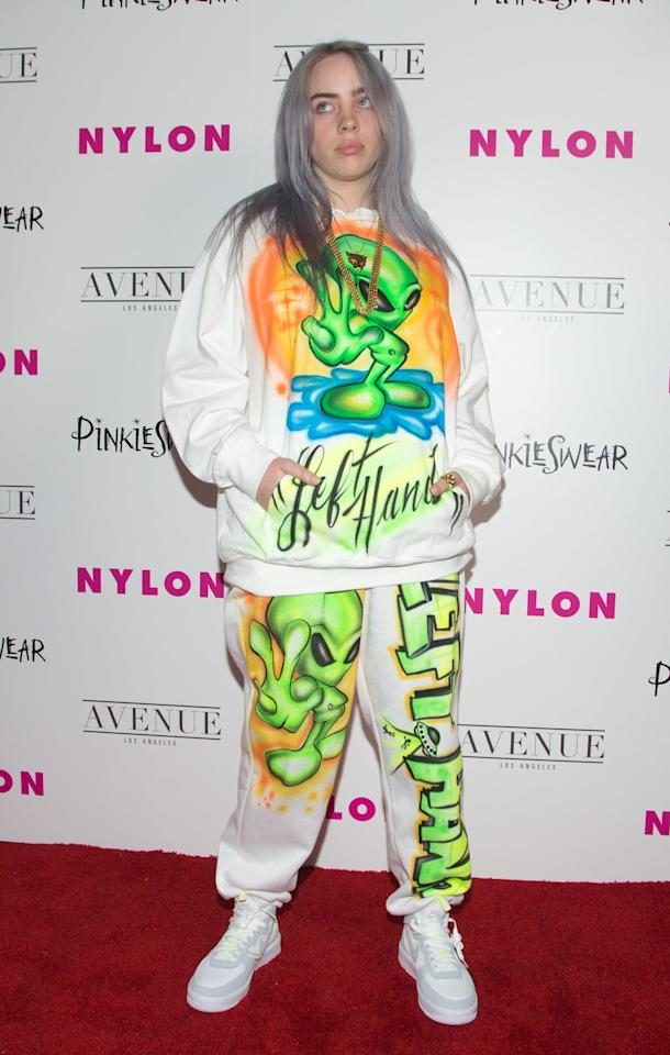 "<p>On the red carpet for the 2018 Young Hollywood Party, Billie choose to sport an airbrush sweatsuit and it was straight out of a '90s dream. Maybe you have some gear left over from storming Area 51, or maybe you want to try your hand at a little <a class=""sugar-inline-link ga-track"" title=""Latest photos and news for DIY"" href=""https://www.popsugar.com/DIY"" target=""_blank"" data-ga-category=""Related"" data-ga-label=""https://www.popsugar.com/DIY"" data-ga-action=""&lt;-related-&gt; Links"">DIY</a> project. <br></p> <p><strong>What to wear: </strong>An alien-themed long-sleeve shirt and sweatpants with plain white sneakers. </p>"