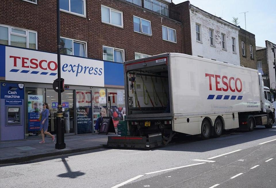 A delivery lorry outside a Tesco Express store in central London (PA Wire)