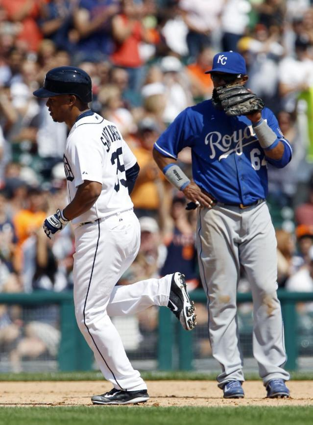 Detroit Tigers' Ramon Santiago, left, rounds the bases past Kansas City Royals third baseman Emilio Bonifacio after hitting a solo home run in the eighth inning during the first game of a doubleheader baseball game Friday, Aug. 16, 2013, in Detroit. The Royals defeated the Tigers 2-1. (AP Photo/Duane Burleson)
