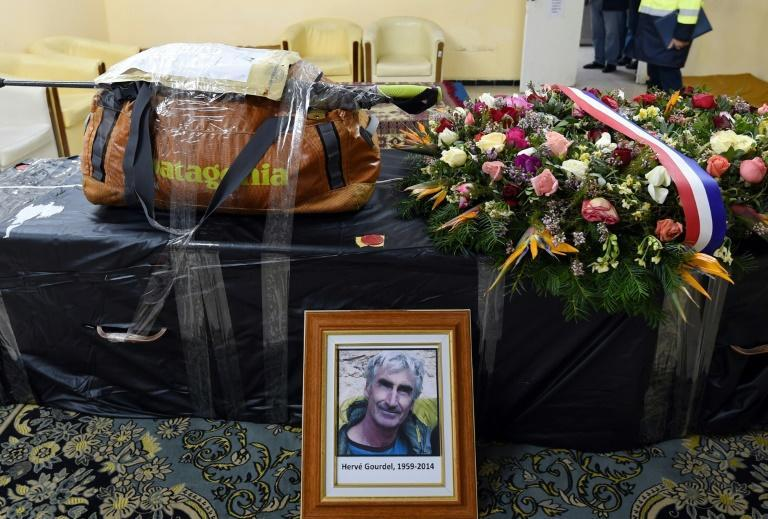The backpack and walking stick of French mountaineer Herve Gourdel, who was kidnapped and beheaded by jihadists in Algeria in 2014, sits on his coffin before it was flown to Paris, in this picture taken on January 26, 2015