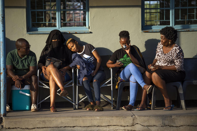 People line up to vote in Botswana's general elections at the Masa primary school in Gaborone Wednesday, Oct. 23, 2019. Polls opened in Botswana on Wednesday as the long-peaceful southern African nation faces what is expected to be its tightest election in history. (AP Photo/Jerome Delay)