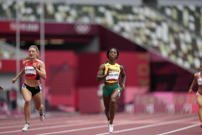 Shelly-Ann Fraser-Pryce, of Jamaica, wins a heat in the women's 100-meter run at the 2020 Summer Olympics, Friday, July 30, 2021, in Tokyo. (AP Photo/Petr David Josek)