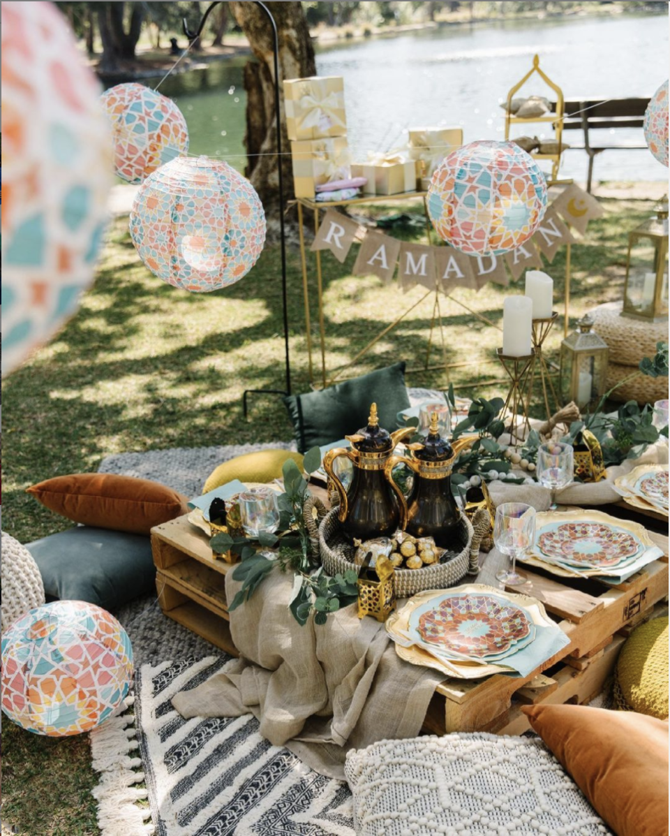"""<p>No table? No problem. Repurpose pallets for a rustic picnic that's full of style. Textured pillows in earthy tones keep things comfy around this table by <a href=""""https://www.instagram.com/p/CM46zGzh3-y/"""" rel=""""nofollow noopener"""" target=""""_blank"""" data-ylk=""""slk:Farsha Events"""" class=""""link rapid-noclick-resp"""">Farsha Events</a>. </p>"""