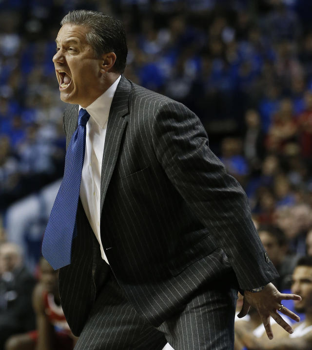 Kentucky head coach John Calipari reacts to play against Arkansas during the first half of the NCAA college basketball Southeastern Conference tournament championship game, Sunday, March 15, 2015, in Nashville, Tenn. (AP Photo/Steve Helber)