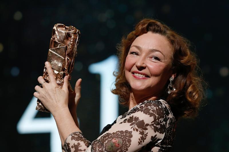 """French actress Catherine Frot poses on stage with her trophy after she won the Best Actress award for """"Marguerite"""" during the 41st edition of the Cesar Ceremony at the Theatre du Chatelet in Paris on February 26, 2016. AFP PHOTO / PATRICK KOVARIK / AFP / PATRICK KOVARIK (Photo credit should read PATRICK KOVARIK/AFP via Getty Images)"""