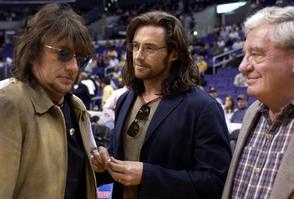 LOS ANGELES - APRIL 27:  (L-R) American musician Richie Sambora, Australian actor Hugh Jackman, and his British-born father Chris confer at the Lakers v Timberwolves in game 4 of the first round of the 2003 NBA playoffs at the Staples Center April 27, 2003 in Los Angeles, California.  (Photo by Vince Bucci/Getty Images)