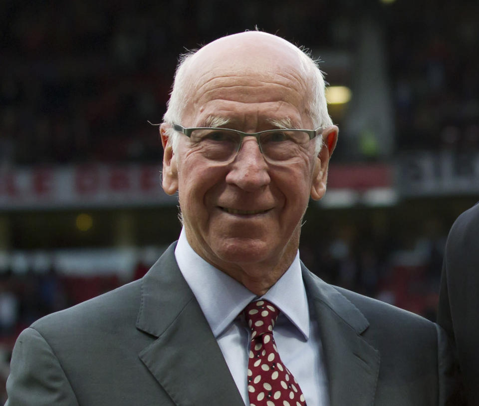 FILE - In this file photo dated Tuesday May 6, 2014, former soccer player Bobby Charlton at Old Trafford Stadium in Manchester, England. Manchester United and England soccer great Bobby Charlton has been diagnosed with dementia, it is revealed Sunday Nov. 1, 2020. (AP Photo/Jon Super, FILE)