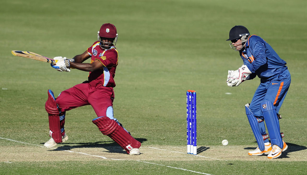 TOWNSVILLE, AUSTRALIA - AUGUST 12:  Anthony Alleyne of the West Indies bats in front of Smit Patel of India during the ICC U19 Cricket World Cup 2012 match between the West Indies and India at Tony Ireland Stadium on August 12, 2012 in Townsville, Australia.  (Photo by Ian Hitchcock-ICC/Getty Images)