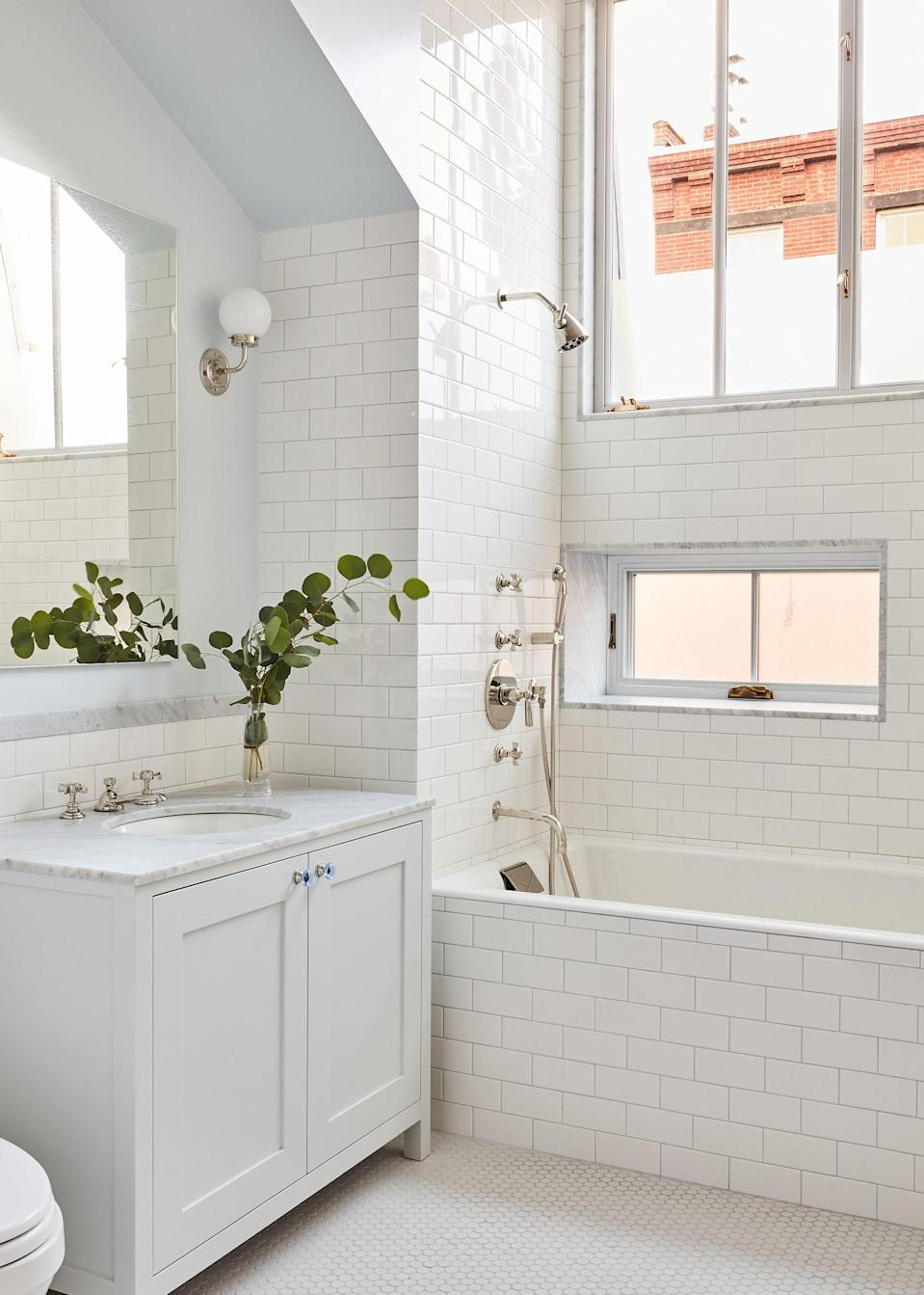 Classic subway tile and a monochromatic white color scheme keep the children's bathroom looking neat and tidy. The hardware is by E.R. Butler & Co.