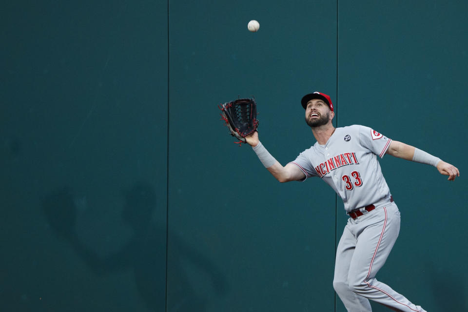 Cincinnati Reds left fielder Jesse Winker catches a fly ball by Philadelphia Phillies' Jay Bruce during the second inning of a baseball game, Friday, June 7, 2019, in Philadelphia. (AP Photo/Matt Slocum)