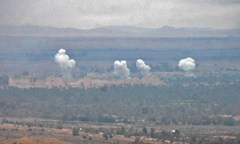 Smoke billows as Syrian regime fighters advance to retake the ancient city of Palmyra from Isis.
