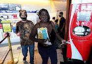"""<p>Adrian Ace (L) and Danielle McNeal, both of Nevada, get snacks at a concession stand before seeing the movie """"Star Wars: Episode V - The Empire Strikes Back"""" at AMC Town Square 18 on August 20 in Las Vegas, Nevada.</p>"""