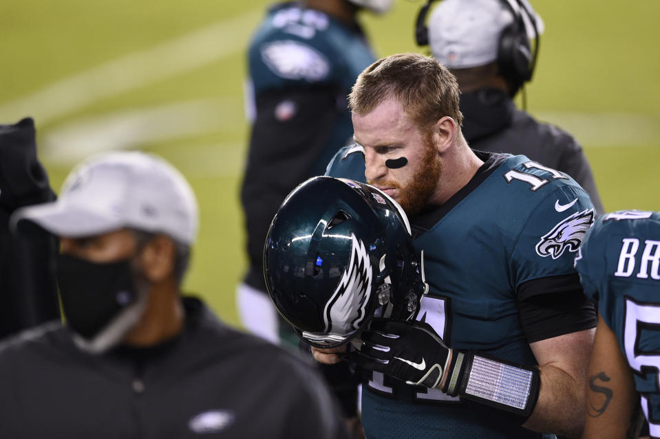 Philadelphia Eagles' Carson Wentz walks the sidelines during the second half of an NFL football game against the Seattle Seahawks, Monday, Nov. 30, 2020, in Philadelphia. (AP Photo/Derik Hamilton)