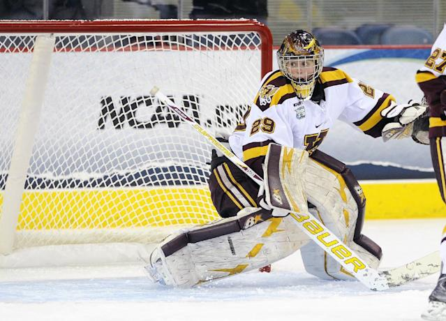 Minnesota goalie Amanda Leveille defends during the first period of an NCAA college hockey game against Clarkson in the finals of the women's Frozen Four in Hamden, Conn., Sunday, March 23, 2014. (AP Photo/Fred Beckham)