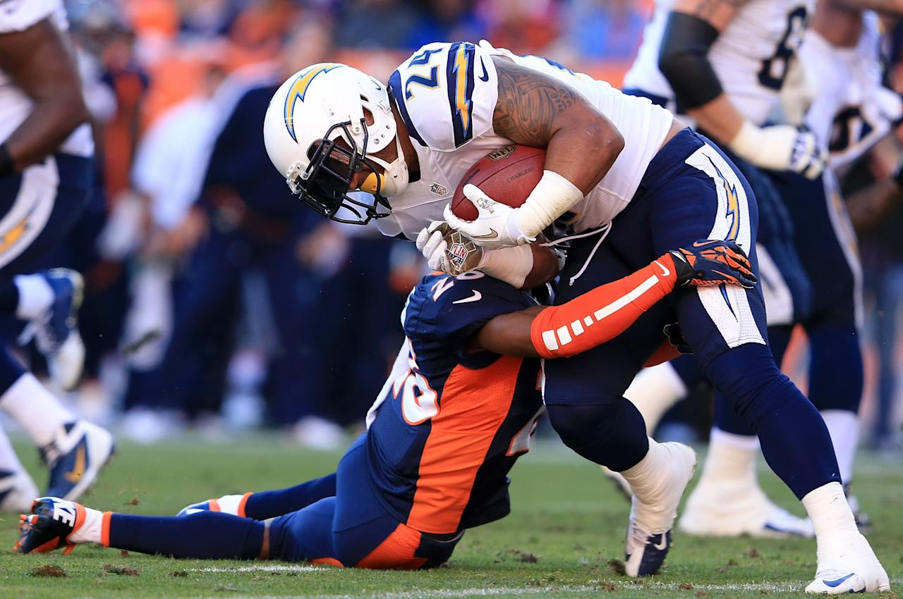 DENVER, CO - NOVEMBER 18:  Running back Ryan Mathews #24 of the San Diego Chargers rushes with the ball as free safety Rahim Moore #26 of the Denver Broncos makes the tackle at Sports Authority Field at Mile High on November 18, 2012 in Denver, Colorado. The Broncos defeated the Chargers 30-23.  (Photo by Doug Pensinger/Getty Images)