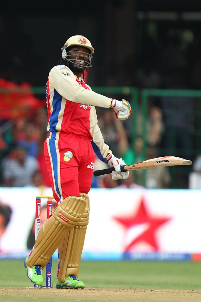 Chris Gayle celebrates his century during match 31 of the Pepsi Indian Premier League between The Royal Challengers Bangalore and The Pune Warriors India held at the M. Chinnaswamy Stadium, Bengaluru  on the 23rd April 2013..Photo by Ron Gaunt-IPL-SPORTZPICS ..Use of this image is subject to the terms and conditions as outlined by the BCCI. These terms can be found by following this link:..https://ec.yimg.com/ec?url=http%3a%2f%2fwww.sportzpics.co.za%2fimage%2fI0000SoRagM2cIEc&t=1506236744&sig=6GAPzuoEie7M.DXmFEUV_w--~D