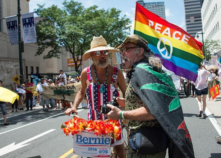 A supporter of Bernie Sanders (L) and a cannabis activist chat as people march in Philadelphia on July 24, 2016 (AFP Photo/Nicholas Kamm)
