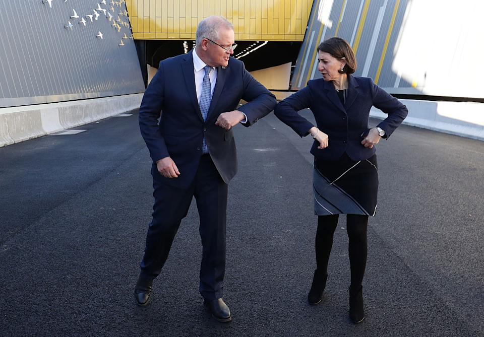 Prime Minister Scott Morrison and NSW Premier Gladys Berejiklian bump elbows after touring the NorthConnex tunnel in Sydney, Australia.