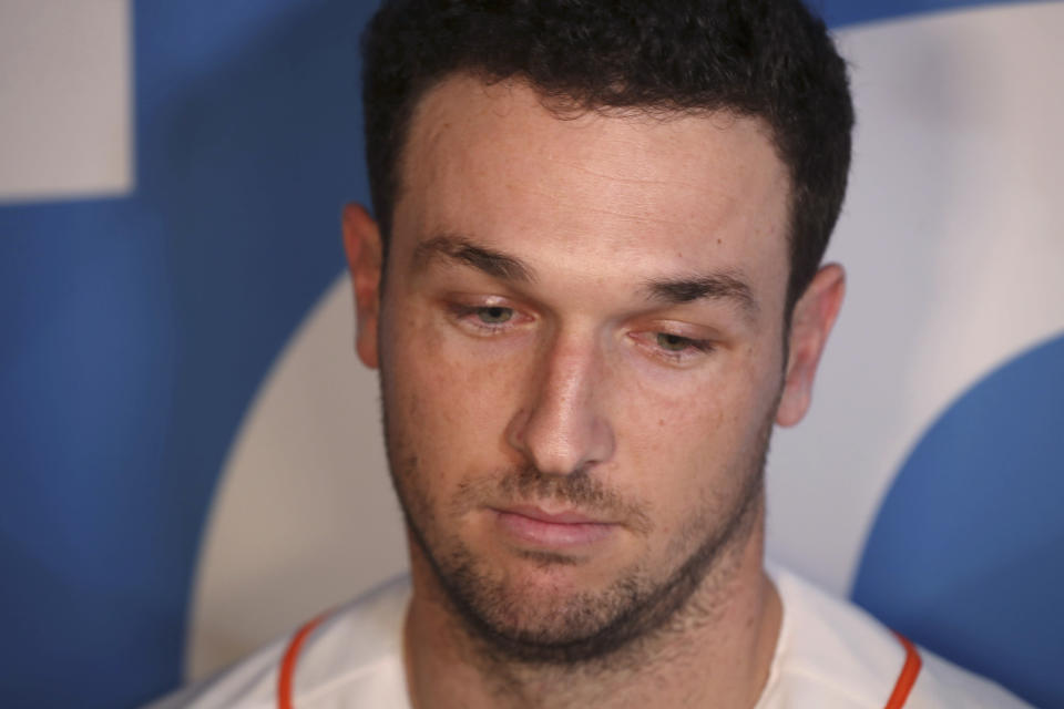 Houston Astors third baseman Alex Bregman is interviewed by the media during the baseball team's FanFest at Minute Maid Park on Saturday, Jan. 18, 2020, in Houston. (Steve Gonzales/Houston Chronicle via AP)