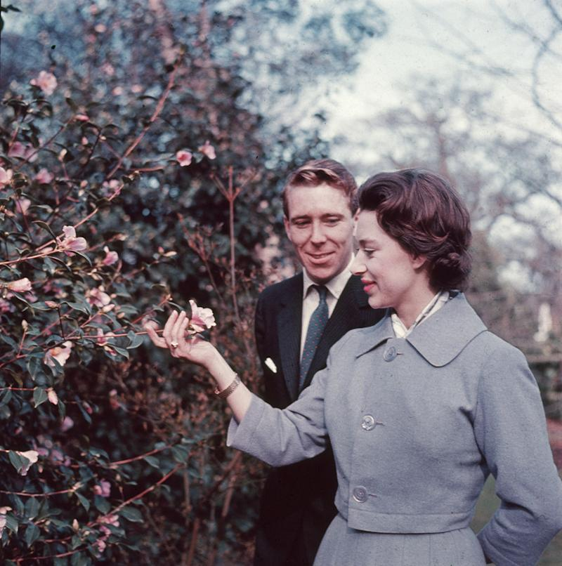 Princess Margaret and Antony Armstrong-Jones in the grounds of Royal Lodge on the day they announced their engagement. Photo by Hulton Archive/Getty Images.