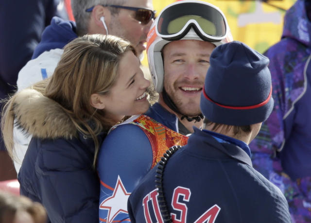 United States' Bode Miller is joined by his wife Morgan after he finished the second run in the men's giant slalom at the Sochi 2014 Winter Olympics, Wednesday, Feb. 19, 2014, in Krasnaya Polyana, Russia. (AP Photo/Gero Breloer)
