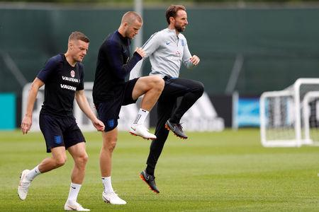 Soccer Football - World Cup - England Training- England Training Camp, Saint Petersburg, Russia - June 25, 2018 England's Jamie Vardy, Eric Dier and England manager Gareth Southgate during training REUTERS/Lee Smith