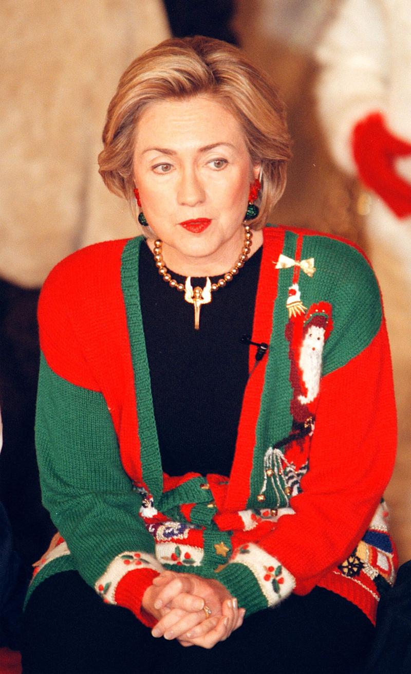 It's Hillary Clinton in a Christmas cardigan. And Christmas earrings. And a Christmas necklace. What more is there to say?