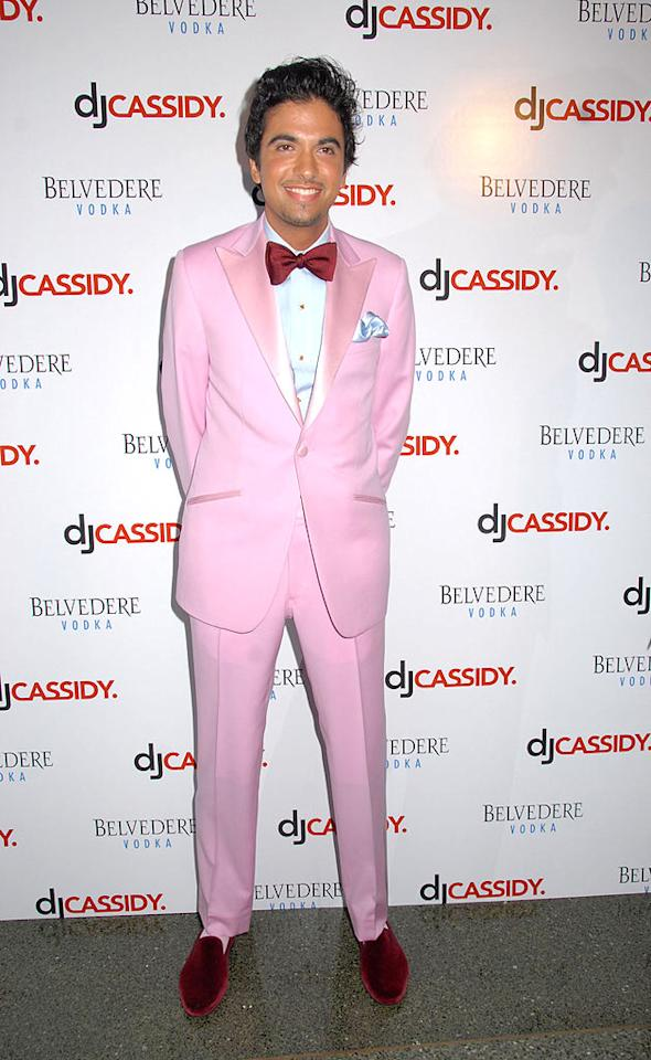 """Since when did pink tuxedos and velvet slippers make a comeback? Perhaps DJ Cassidy is at the forefront of fashion. We beg to differ. Johns PkI/<a href=""""http://www.splashnewsonline.com"""" target=""""new"""">Splash News</a> - July 9, 2008"""