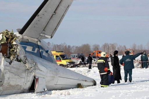 A photo provided on April 2, 2012 by the Russian Emergencies Ministry shows rescuers and investigators working at the site of a plane crash which killed 31 people on Monday. The French-Italian made ATR-72 passenger plane run by private Russian airline UTair came down moments after takeoff some 45 km (28 miles) from the western Siberian city of Tyumen