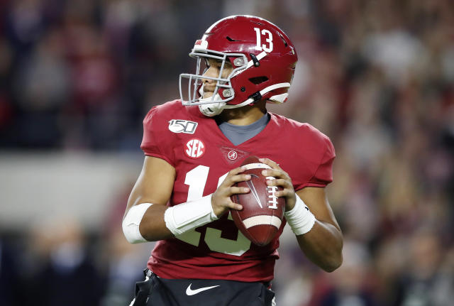 Tua Tagovailoa could be an extremely difficult evaluation for NFL scouts now. (Photo by Todd Kirkland/Getty Images)