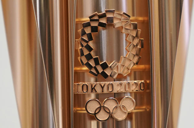 FILE - This March 20, 2019, file photo shows the emblem of the Olympic torch of the Tokyo 2020 Olympic Games during a press conference in Tokyo. Tokyo organizers said Wednesday, May 8, 2019, they are trying to cut spending, under pressure from the International Olympic Committee, which has been widely criticized for driving Olympic cities to build white elephant venues, often at the taxpayers expense. (AP Photo/Eugene Hoshiko, File)