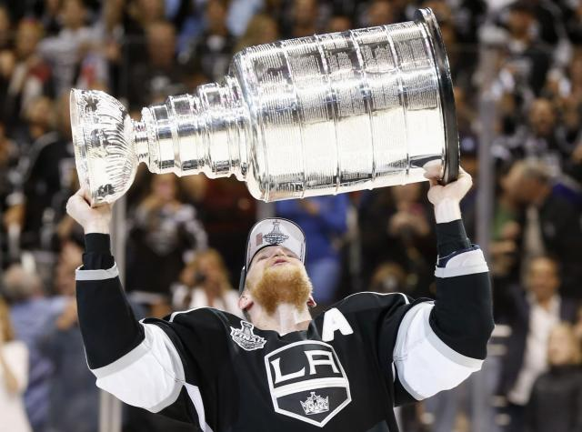 Los Angeles Kings' Anze Kopitar celebrates with the Stanley Cup after the Kings defeated the New York Rangers in Game 5 of their NHL Stanley Cup Finals hockey series in Los Angeles, California, June 13, 2014. REUTERS/Lucy Nicholson (UNITED STATES - Tags: SPORT ICE HOCKEY)